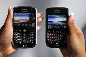 "Photo - In this Monday, Sept. 21, 2009, file photo, a BlackBerry Bold, left, and Tour, right are photographed in Mountain View, Calif., Monday, Sept. 21, 2009.Troubled smartphone maker BlackBerry has won an early round in its legal battle against an iPhone keyboard made by a startup co-founded by ""American Idol"" host Ryan Seacrest. (AP Photo/Paul Sakuma, File)"