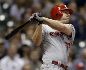 photo -   Cincinnati Reds' Jay Bruce hits a three-run home run during the fourth inning of a baseball game against the Milwaukee Brewers Monday, May 7, 2012, in Milwaukee. (AP Photo/Morry Gash)