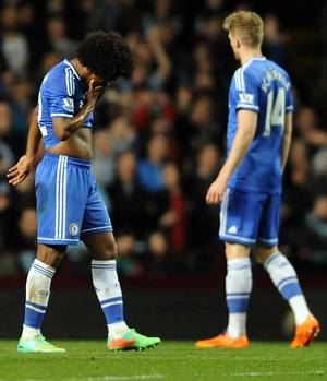 Photo - Chelsea's Willian, left, leaves the pitch after being sent off during the English Premier League soccer match between Aston Villa and Chelsea at Villa Park, Birmingham, England, Saturday, March 15, 2014.  (AP Photo/Rui Vieira)