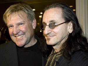 Photo -   FILE - Alex Lifeson, left, and Geddy Lee of the rock band RUSH arrive for the Canadian Music Industry Awards in Toronto,in this Thursday, March 8, 2007 file photo. Rush is among the group of first-time nominees for the Rock and Roll Hall of Fame.(AP Photo/CP, Frank Gunn, File)