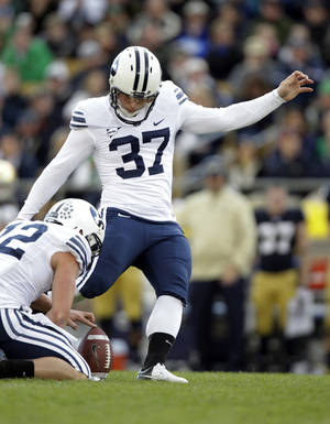 Photo -   BYU kicker Justin Sorensen misses a field goal from the hold of JD Falslev during the second half of an NCAA college football game against Notre Dame in South Bend, Ind., Saturday, Oct. 20, 2012. Notre Dame defeated BYU 17-14. (AP Photo/Michael Conroy)