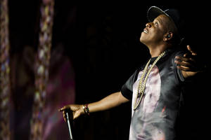 """Photo - FILE - In this Sept. 1, 2012 file photo, Jay-Z performs at the """"Made In America"""" music festival in Philadelphia. Jay Z will perform at DirecTV's Super Bowl Eve party in New York. (Photo by Charles Sykes/Invision/AP, File)"""
