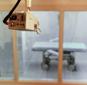 Photo -   FILE - In this July 30, 1997, file photo a television camera mounted on the ceiling of a witness room is pointed toward the death chamber at Cummins Prison in Varner, Ark. The Arkansas Supreme Court struck down the state's execution law Friday, June 22, 2012, calling it unconstitutional. (AP Photo/Danny Johnston, File)