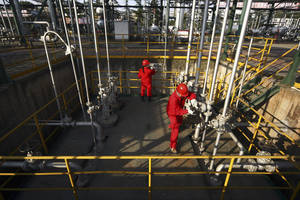 Photo -  PetroChina workers perform a routine check on the Moxi Natural Gas Purification Plant in Suining in southwest China's Sichuan province. AP File Photo  <strong> -  AP </strong>