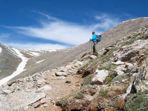 Photo - Johnny Hunter, of Shawnee, looks toward the Angel of Shavano in June. It would be one of two snow slopes that would be climbed on Mount Shavano, a 14,229-foot peak near Salida, Colo. (Photo by Bob Doucette, The Oklahoman)