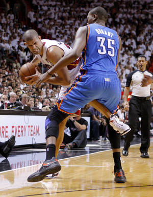 Photo - Oklahoma City's Kevin Durant (35) defends Miami's Shane Battier (31) during Game 4 of the NBA Finals between the Oklahoma City Thunder and the Miami Heat at American Airlines Arena, Tuesday, June 19, 2012. Photo by Bryan Terry, The Oklahoman