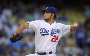 Photo - FILE - In this Aug. 27, 2013, file photo, Los Angeles Dodgers starting pitcher Clayton Kershaw throws to the plate during the first inning of a baseball game against the Chicago Cubs in Los Angeles. Kershaw won the National League Cy Young Award, Wednesday, Nov. 13, 2013. (AP Photo/Mark J. Terrill, File)