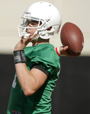 Photo - COLLEGE FOOTBALL: Wes Lunt (11) passes the ball during the OSU spring football practice at Boone Pickens Stadium on the campus of Oklahoma State University in Stillwater, Okla., Monday, March 12, 2012. Photo by Nate Billings, The Oklahoman