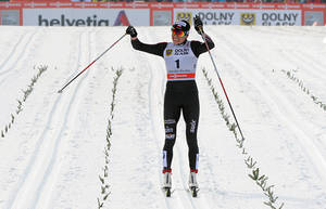 Photo - Poland's Justyna Kowalczyk celebrates as she wins the women's Cross Country skiing 10km Mass Start Classic World Cup event in Szklarska Poreba, Poland, Sunday, Jan. 19, 2014. (AP Photo/Alik Keplicz)