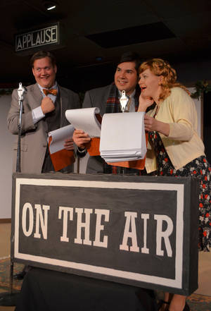 "Photo - An old school chum (Curt Rose, left) delivers a familiar ""hee haw"" during a phone call to George Bailey and Mary (David Burkhart and JJ Arends) in ""It's a Wonderful Life."" <strong></strong>"