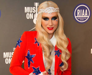 photo - Ke$ha arrives at the 2013 Presidential Inaugural Charity Benefit, on Monday, Jan. 21, 2013 in Washington. (Photo by Stephen Boitano/Invision/AP)