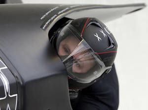 Photo -   United States 1 pilot Steven Holcomb, with brakeman Steven Langton, races to the win the two-man bobsled World Cup competition on Friday, Nov. 9, 2012, in Lake Placid, N.Y. (AP Photo/Mike Groll)