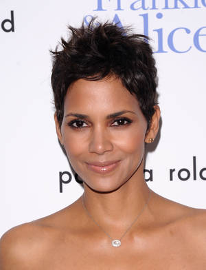 "Photo - FILE - In this Nov. 17, 2010 file photo, actress Halle Berry attends a special screening of ""Frankie & Alice"" in New York. It's a boy for Halle Berry and Olivier Martinez.  A representative for the 47-year-old actress confirms that the couple welcomed their son on Saturday, Oct. 5, 2013  (AP Photo/Peter Kramer, file)"