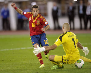 Photo - Spain's Jordi Alba scores the opening goal past Finnish goalie Niki Mäenpää  during their World Cup group I qualifying soccer match at the Olympic Stadium in Helsinki, Friday Sept. 6, 2013. (AP Photo/Lehtikuva, Timo Jaakonaho) FINLAND OUT