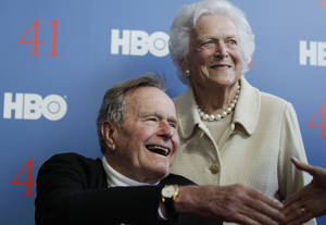 "Photo - FILE - In a Tuesday, June 12, 2012 file photo, former President George H.W. Bush, and his wife, former first lady Barbara Bush, arrive for the premiere of HBO's new documentary on his life near the family compound in Kennebunkport, Maine. Bush spokesman Jim McGrath said Wednesday, Dec. 26. 2012 that doctors at the Houston hospital where Bush has been treated for a month remain ""cautiously optimistic"" that he will recover. Still, no discharge date has been set, and McGrath says that doctors are being cautious because at Bush's age ""sometimes issues crop up that are beyond anybody's ability to discern or foretell.""(AP Photo/Charles Krupa, File)"