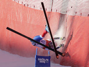 Photo - France's Marie Marchand-Arvier crashes into safety netting during the women's downhill at the Sochi 2014 Winter Olympics, Wednesday, Feb. 12, 2014, in Krasnaya Polyana, Russia. (AP Photo/Charles Krupa)