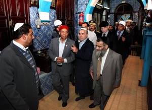 Photo -   President Moncef Marzouki, center, visits the synagogue on Djerba island, Tunisia Wednesday, April 11, 2012 to mark the 10th anniversary of an al-Qaida truck bomb at the synagogue that killed 21 people. It comes at a time when Tunisia's small, 1,500-strong, Jewish community is facing pressure from ultraconservative Muslim groups, after an uprising last year overthrew Tunisia's decades-old secular dictatorship. (AP Photo)