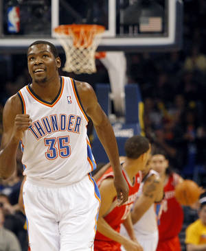 Photo - Oklahoma City's Kevin Durant celebrates after the Thunder scoer points against Houston during their NBA basketball game at the OKC Arena in downtown Oklahoma City on Wednesday, Nov. 17, 2010. Photo by John Clanton, The Oklahoman