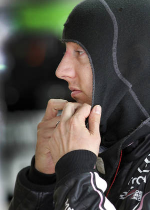 Photo - Kyle Busch prepares for practice for Saturday's NASCAR Sprint Cup series auto race at Charlotte Motor Speedway in Concord, N.C., Friday, Oct. 11, 2013. (AP Photo/Terry Renna)