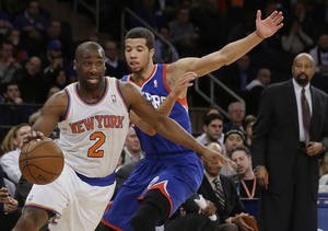 Photo - New York Knicks' Raymond Felton (2) drives past Philadelphia 76ers' Michael Carter-Williams (1) during the first half of an NBA basketball game, Wednesday, Jan. 22, 2014, in New York.  (AP Photo/Frank Franklin II)