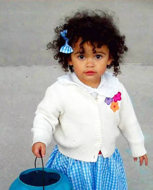 photo - This October 2011 photo provided by Melanie Capobianco shows her adoptive daughter, Veronica, trick-or-treating in Charleston, S.C.  Her adoption case is pitting the Capobiancos, who nurtured her since birth, against the girl's birth father, who was recently awarded custody. AP Photo