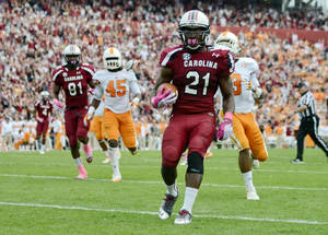 Photo -   South Carolina running back Marcus Lattimore scores a touchdown during the second quarter of an NCAA college football game against Tennessee, Saturday, Oct. 27, 2012, at Williams-Brice Stadium in Columbia, S.C.(AP Photo/Richard Shiro)