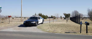 photo - Police blocking the drive to keep people out of a house in the 11000 block of S Bryant where a standoff and homicide occurred in Oklahoma City Wednesday, Nov 14, 2012. Photo by Paul B. Southerland, The Oklahoman