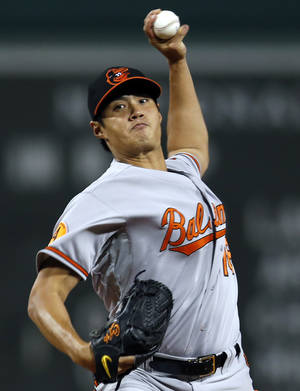 Photo - Baltimore Orioles starting pitcher Wei-Yin Chen (16) delivers to the Boston Red Sox in the first inning of a MLB American League baseball game at Fenway Park in Boston, Wednesday, Sept. 18, 2013. (AP Photo/Elise Amendola)