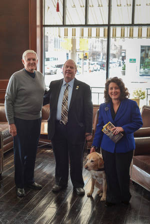 "Photo -  Southern Nazarene University President Loren Gresham, left, and Shannon Warren, founder/director of The Oklahoma Business Ethics Consortium, visit with author and speaker Michael Hingson and his guide dog ""Africa.""   <strong> -  PHOTO PROVIDED </strong>"