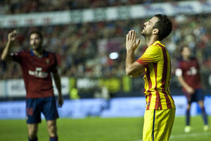 Photo - FC Barcelona's Francesc Fabregas, right, reacts after missing a goal during their Spanish League soccer match against Osasuna, at El Sadar stadium, in Pamplona northern Spain on Saturday, Oct. 19, 2013. (AP Photo/Alvaro Barrientos)