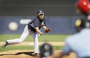 Photo - New York Yankees pitcher Masahiro Tanaka throws a pitch during the sixth inning of an exhibition baseball game against the Philadelphia Phillies Saturday, March 1, 2014, in Tampa, Fla. (AP Photo/Charlie Neibergall)