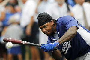 Photo - Los Angeles Dodgers' Hanley Ramirez hits the ball while waiting his turn at batting practice before a baseball game against the the Kansas City Royals at Kauffman Stadium in Kansas City, Mo., Monday, June 23, 2014.  (AP Photo/Colin E. Braley)