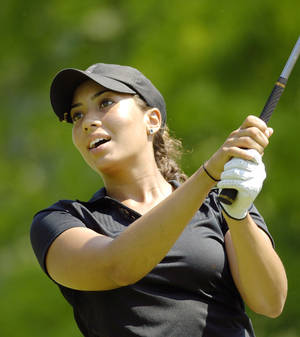 Photo -   FILE - This June 25, 2009 file photo shows Cheyenne Woods watching her ball from the eighth tee during the first round of the 2009 Wegmans LPGA golf tournament, in Rochester, N.Y. While Uncle Tiger Woods plays across the state in Charlotte, his niece looks to wrap up her Wake Forest career with a strong showing at the NCAA regionals next week before she turns pro. (AP Photo/ Don Heupel, File)