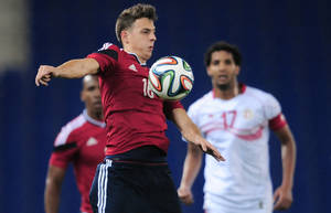 Photo - Colombia's Santiago Arias, left, duels for the ball against Tunisia' s Jomar during an international friendly soccer match at Cornella-El Prat stadium in Cornella Llobregat, Spain, Wednesday, March 5, 2014. (AP Photo/Manu Fernandez)