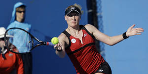 Photo - Britain's Elena Baltacha makes a forehand return during her first round match against France's Stephanie Foretz Gacon at the Australian Open tennis championship, in Melbourne, Australia, Monday, Jan. 16, 2012. (AP Photo/Aaron Favila)