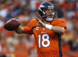 photo -   Denver Broncos quarterback Peyton Manning looks to pass against the Pittsburgh Steelers during the first quarter of an NFL football game, Sunday, Sept. 9, 2012, in Denver. The Broncos won 31-19. Manning got his first touchdown as a Bronco and the 400th of his career with a 71-yard pass to Demaryius Thomas during the third quarter. (AP Photo/David Zalubowski)  