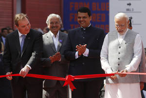 Indian Prime Minister Narendra Modi, right, and Sweden Prime Minister Stefan Löfven, right, inaugurate the 'Make in India' centre in Mumbai, India, Saturday, Feb 13, 2016. 'Make in India' is an initiative launched last year to encourage international companies to manufacture their goods in India. (AP Photo/Rajanish Kakade)