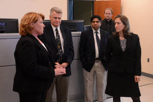 Photo - This photo taken April 4, 2014, shows West Virginia Secretary of State Natalie Tennant, right, speaking with Sen. Heidi Heitkamp, D-N.D., left, during a tour of the National Research Center for Coal & Energy on WVU's Evansdale Campus in Morgantown, W.Va.  Tennant hopes her allegiance to West Virginia's coal industry is enough to separate herself from President Barack Obama and retain a Senate seat for Democrats in a state that has sprinted to the right. It's a proven strategy for Democrats in Republican-leaning energy producing states, used by West Virginia's two senators, Joe Manchin and retiring Jay Rockefeller, and their colleagues like Mark Begich in Alaska, Mary Landrieu in Louisiana and Heidi Heitkamp in North Dakota. The question in the November elections is whether that's enough to hold onto a tenuous Senate majority with Republicans gunning for more than a half-dozen seats in states like West Virginia, where Obama lost and remains unpopular.  (AP Photo/The Dominion Post, Matt Sunday)