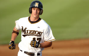 Photo - FILE - In this June 3, 2007, file photo, Missouri's Aaron Senne rounds second base after hitting a solo home run in the second inning of an NCAA Regional baseball game against Louisville in Columbia , Mo. Senne and former minor-league players in each of the 30 big-league organizations are suing Major League Baseball, alleging violations of federal wage and overtime laws in a case some legal observers suggest has significant merit. (AP Photo/L.G. Patterson, File)