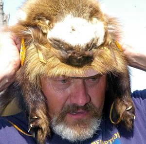 Photo - Kevin Martin shows one of the hats he made from animal skins. (Lawton Constitution photo)