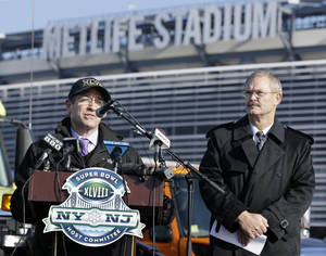 Photo - President and CEO of MetLife stadium, Brad Mayne, right, listens as Frank Supovitz, left, senior vice president of events for the National Football League, answers a question at MetLife stadium in East Rutherford, N.J., Wednesday, Dec. 18, 2013, as officials demonstrated snow removal and melting machinery and outlined emergency weather scenarios and contingency plans for the Super Bowl in February. (AP Photo/Mel Evans)