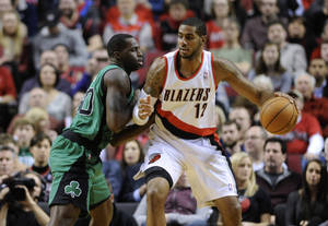 Photo - Boston Celtics' Brandon Bass (30) defends against Portland Trail Blazers' LaMarcus Aldridge (12) during the first half of an NBA basketball game in Portland, Ore., Saturday, Jan. 11, 2014. (AP Photo/Greg Wahl-Stephens)