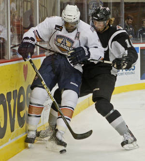photo - Shawn Belle of the Oklahoma CIty Barons and Ryan Weston of the San Antonio Rampage battle for the puck during an AHL hockey game at the Cox Convention Center in Oklahoma City, Tuesday, Nov. 9, 2010.  Photo by Bryan Terry, The Oklahoman ORG XMIT: KOD