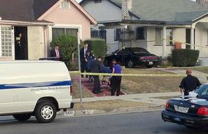"Photo - Los Angeles County coroner's officials remove the body of April Jace, the wife of actor Michael Jace, from the couple's home in the Hyde Park area of Los Angeles Tuesday morning, May 20, 2014. Michael Jace, who played a police officer on the hit TV show ""The Shield,"" was arrested Tuesday on suspicion of shooting his wife to death, authorities said. (AP Photo/Dwight Flowers)"
