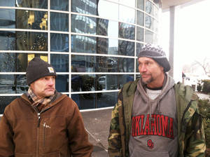 photo - Charles Scott, left, and Jeff Hancock, who are homeless, talk Friday outside the Ronald J. Norick Downtown Library. Photo by Phillip O'Connor, The Oklahoman