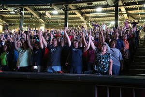 "Photo - People join hands during the recent  ""As One Church: Some Assembly Required"" ecumenical event at the Chickasaw Bricktown Ballpark in downtown Oklahoma City. Photo provided by Stephen Thomas of OKC Memories  <strong></strong>"