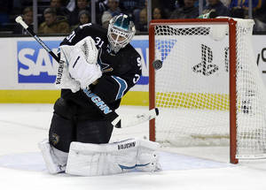 Photo - San Jose Sharks goalie Antti Niemi (31), of Finland, deflects a shot on goal against the Minnesota Wild during the second period of an NHL hockey game on Thursday, Dec. 12, 2013, in San Jose, Calif. (AP Photo/Marcio Jose Sanchez)