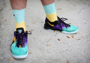 Photo - Rob Starkman, Rock 'Em Apparel founder, sports the Kobe 8 Easter socks that are made to go with the Kobe 8 Easter shoe, April 3, 2013, at his Orlando, Florida home where the socks are designed and shipped. (Jacob Langston/Orlando Sentinel/MCT)