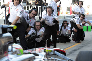 Photo - McLaren mechanics wait as driver Sergio Perez of Mexico steers his car into pit lane during the second practice session for the Korean Formula One Grand Prix at the Korean International Circuit in Yeongam, South Korea, Friday, Oct. 4, 2013.(AP Photo/Aaron Favila)