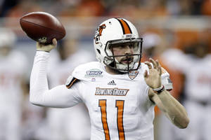 Photo - Bowling Green quarterback Matt Johnson throws during the first quarter of an NCAA college football game against Northern Illinois at the Mid-American Conference championship in Detroit, Friday, Dec. 6, 2013. (AP Photo/Carlos Osorio)
